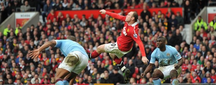 Manchester United's Wayne Rooney (centre) scores their second goal from inside the penalty area from an overhead kick